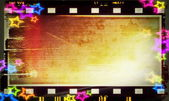 Blank old grunge film strip with stars background — Stock Photo