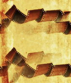 Old grunge film strip roll frame background — Stock Photo