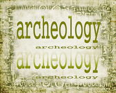 Concept of archeology on old paper background with ornaments — Stock Photo
