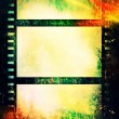 Stock Photo: Grunge colorful film strip background