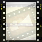Film strip frame and movie projector — Stock Photo