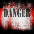 Danger on grunge bloody background — Stock Photo