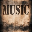 Music word, old rusty wall background and texture — Stock Photo