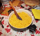 Polenta corn traditional food cooking in dish, porridge made from cornmeal — Stock Photo