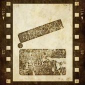 Clapper board and old grunge film strip background — 图库照片