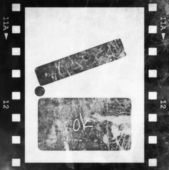 Clapper board and old grunge film strip background — Photo
