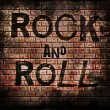 Rock and roll music word on red wall background — Stock Photo #42140187