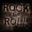 Rock and roll music word on red wall background — Stock Photo #42140397