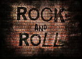 Rock and roll music word on red wall background — Foto Stock