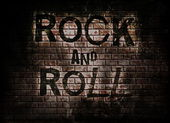 Rock and roll music word on red wall background — Стоковое фото