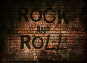 Rock and roll music word on red wall background — Foto de Stock