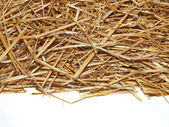 Pile straw isolated on white — Stock Photo
