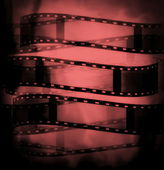 Red black film roll background and texture — Stock Photo