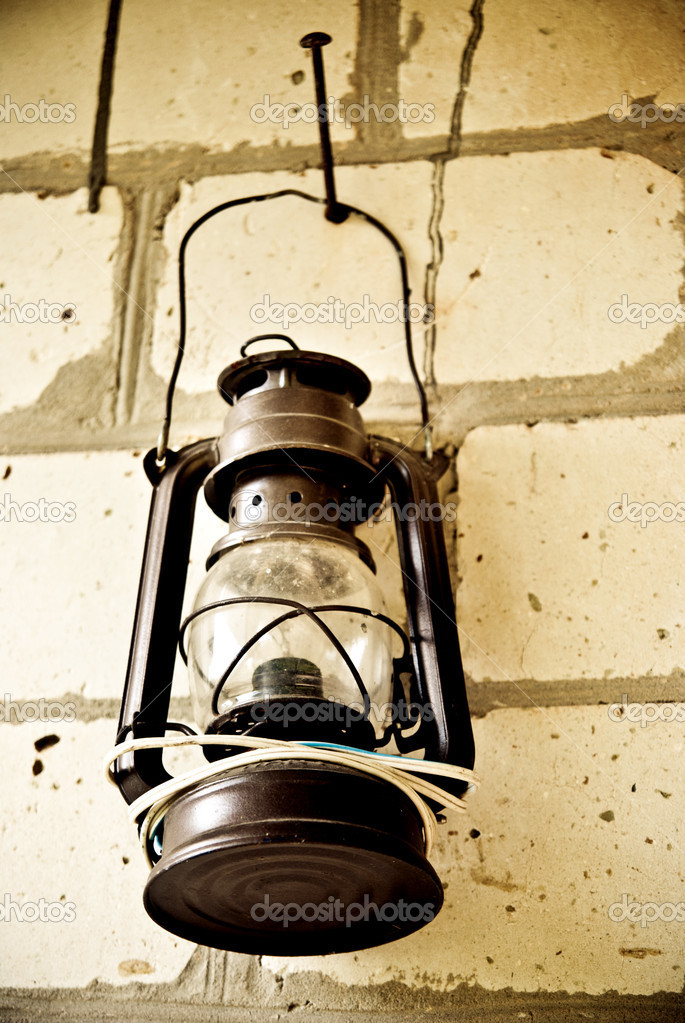 Kerosene lamp hanging on a brick wall  — Stock Photo #14021237