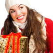 Happy amiling woman holding Christmas gift — Stock Photo