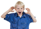 Angry frustrated young boy — Stock Photo