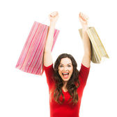 Thrilled beautiful woman Christmas shopping. — Stock Photo