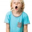 Tired young boy yawning — Stock Photo