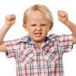 Angry young boy - Stock Photo