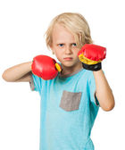Serious angry boy with boxing gloves — Stock Photo