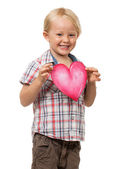 Cute young boy holding love heart — Stock Photo