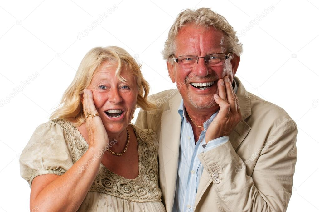 Very happy and surprised attractive mmature couple looking at camera. Isolated on white. — Stock Photo #19718907