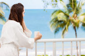 Woman on a tropical balcony — Stock Photo