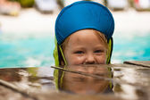 Cute young boy playing in water — Stock Photo