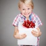 Very happy boy holding present — Foto Stock