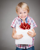 Very happy boy holding present — Stok fotoğraf