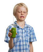 Funny boy unhappy about green smoothie — Stock Photo