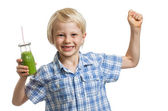 Healthy boy with green smoothie — Stock Photo