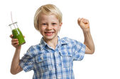 Boy with green smoothie flexing muscles — Stock Photo