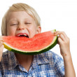 Boy taking big bite of water melon — Stock Photo