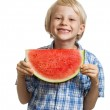 Cute boy holding slice of water melon — Stock Photo #33592381