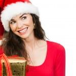 Women holding Christmas gift — Stock Photo #34202775