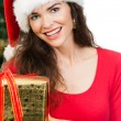 Close-up of women holding Christmas gift — Stok fotoğraf