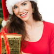 Close-up of women holding Christmas gift — Stock Photo #34202939