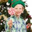 Elf boy holding lollipop — Foto Stock