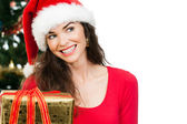 Women holding Christmas gift — Foto Stock