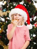 Santas helper eating gingerbread — Stock Photo