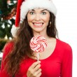 Funny happy woman holding lollipop — Stock Photo #34381881