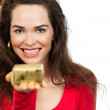 Beautiful woman holding out Christmas gift — Stock Photo