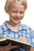 Cute boy reading book. — Stock Photo