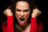 Vary angry woman clenching fists — Stock Photo