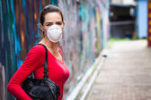 Unhappy woman wearing face mask  — Stock Photo