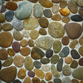Wall round stone rock texture — Stock Photo