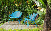 Blue chair in garden — Stock Photo