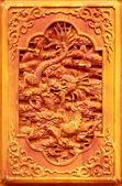 Dragon design on the wooden door — Stock Photo
