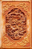 Dragon design on the wooden door — Stock Photo